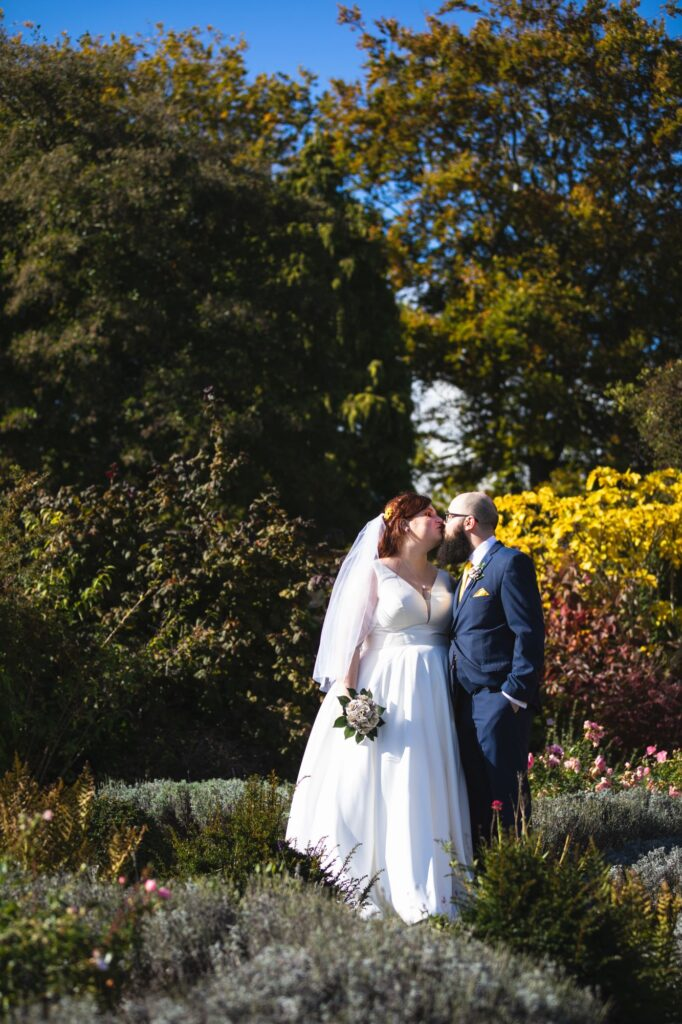bride groom kiss caswell house cottage garden oxfordshire wedding photography