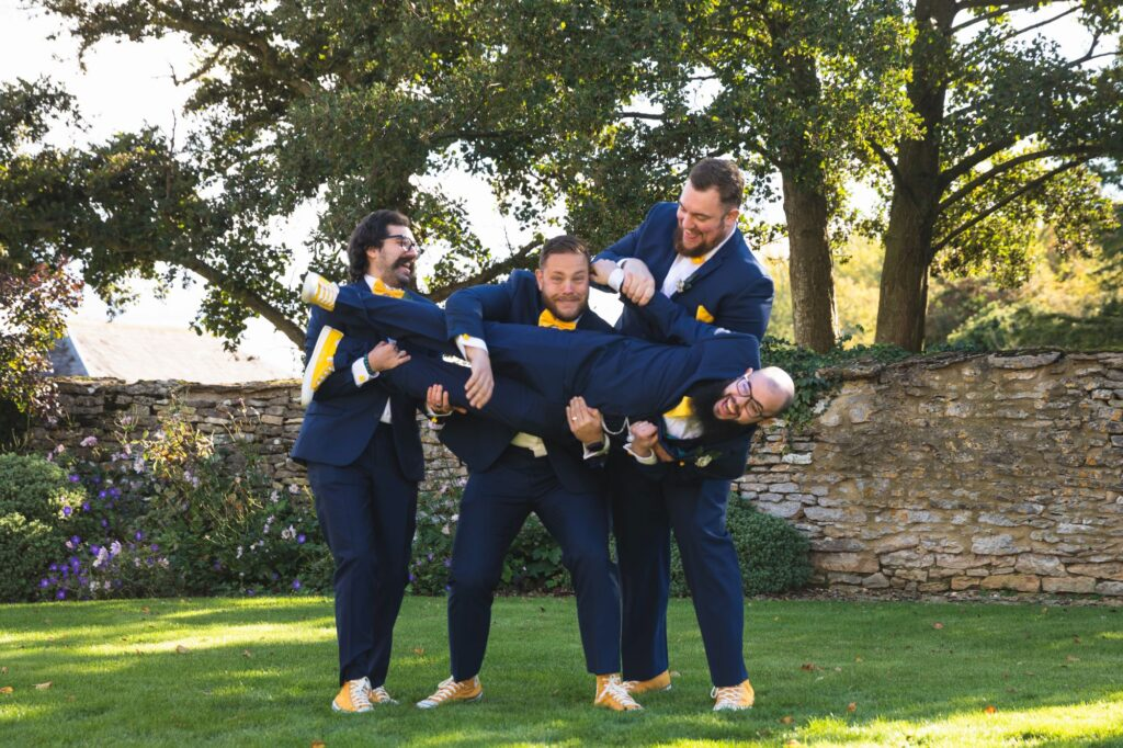 grooms lift groom caswell house grounds oxford wedding photographers