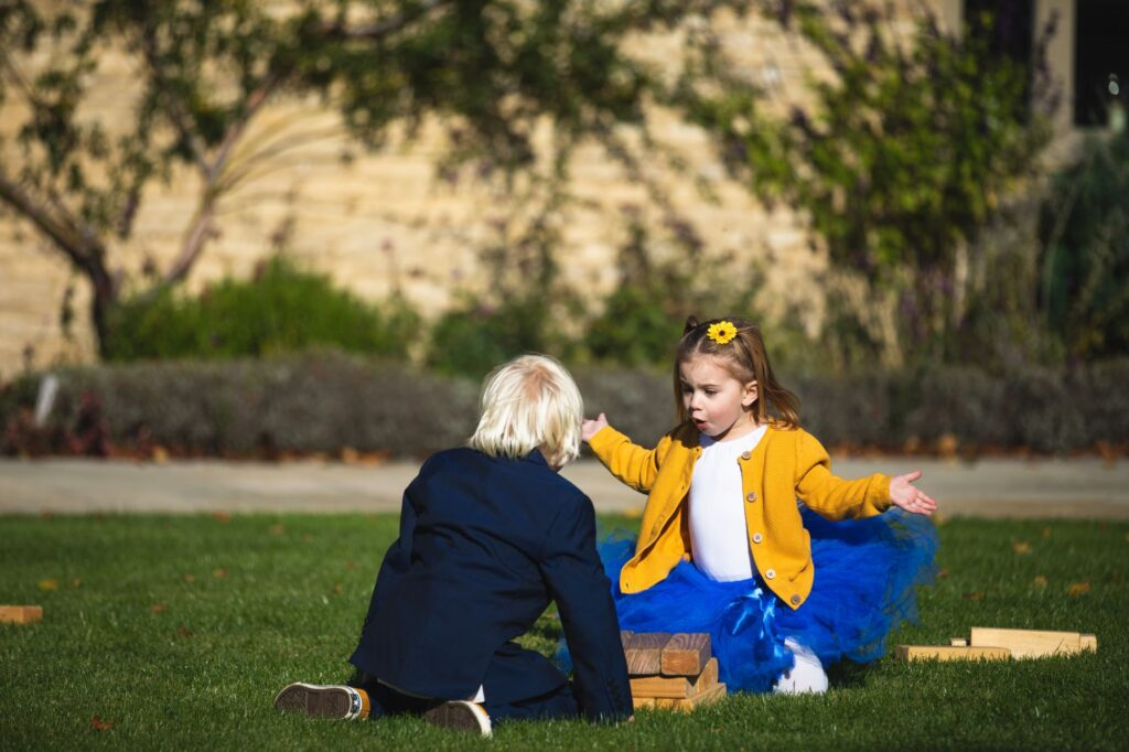 youngsters play outdoor game caswell house gardens oxford wedding photography