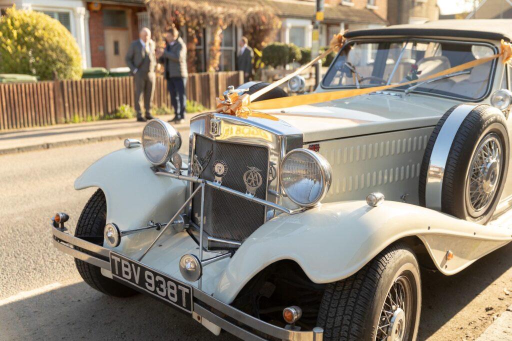 bridal car arrives brides home danson park marriage ceremony oxford wedding photographers