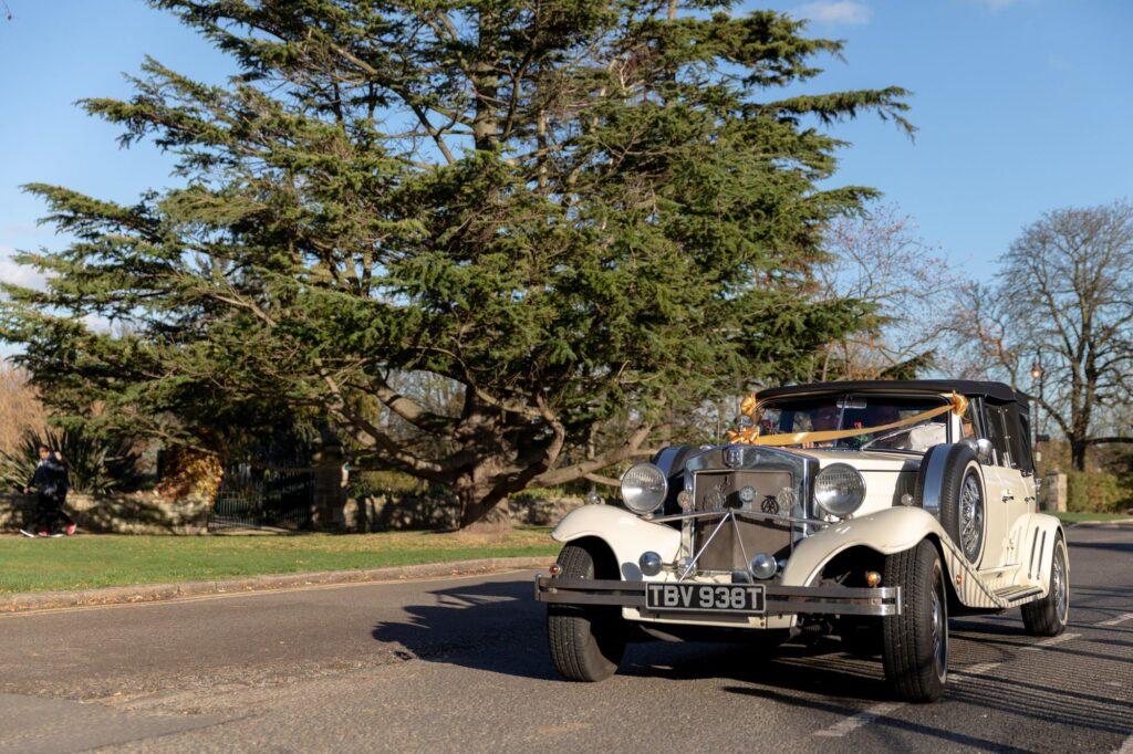 brides vintage bridal car arrives danson park bexleyheath oxfordshire wedding photographers