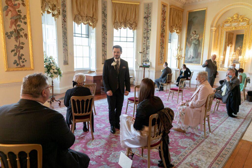 groom guests await bride danson house ceremony bexleyheath oxfordshire wedding photographer