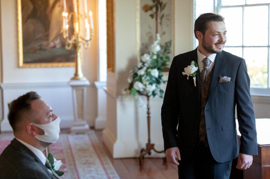 smiling groom awaits brides arrival danson house ceremony bexleyheath oxford wedding photography