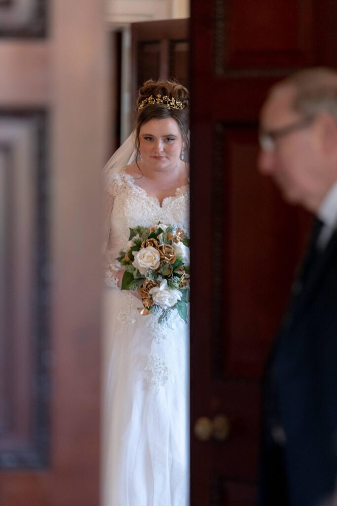 door opens bride enters marriage ceremony danson house bexleyheath oxfordshire wedding photographer
