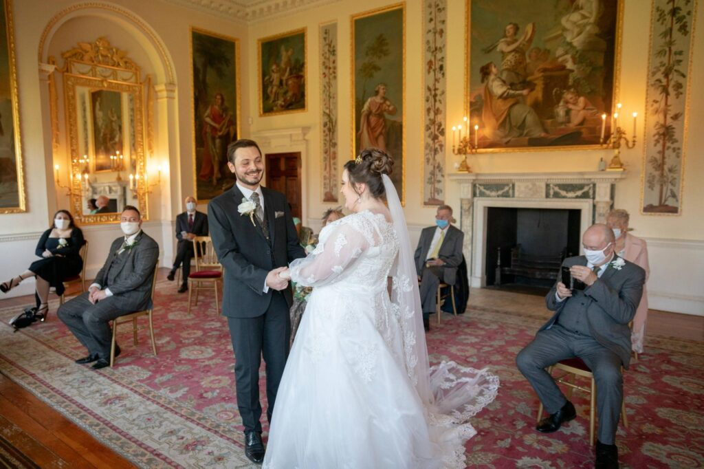 smling bride groom hold hands marriage ceremony danson house bexleyheath oxfordshire wedding photographer