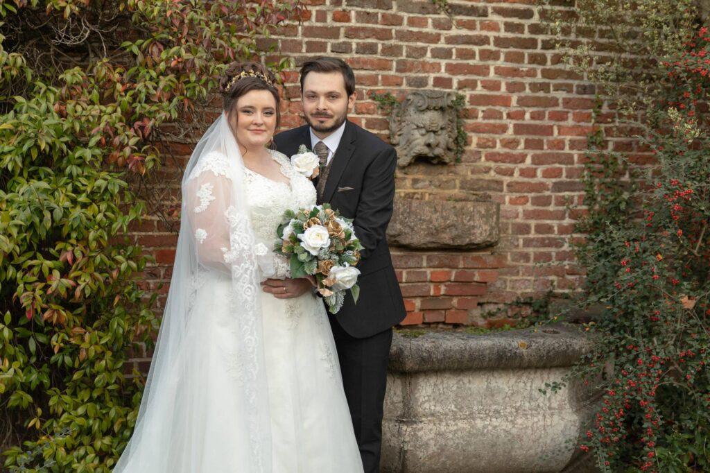 bride grooms portrait by water feature danson house and park bexleyheath oxfordshire wedding photographer