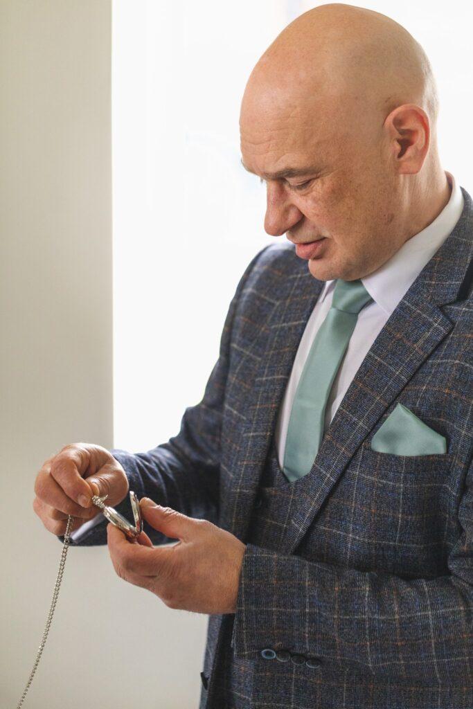 father of bride examines pocket watch gift rishworth sowerby bridge marriage oxford wedding photographer