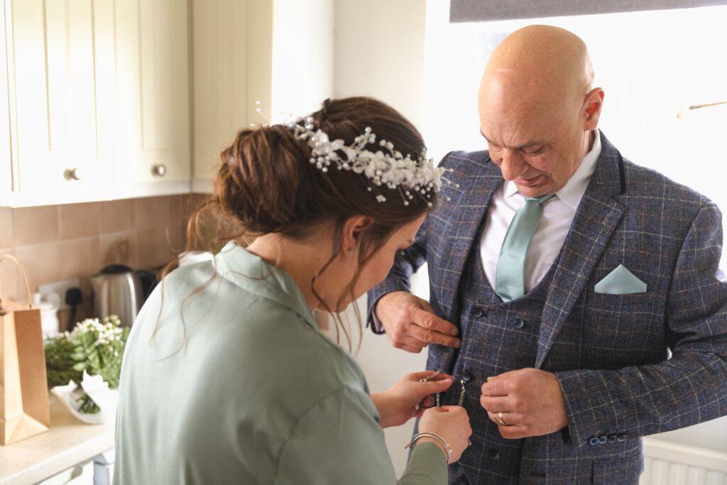 bride attaches father of brides pocket watch rishworth sowerby bridge marriage oxford wedding photographers