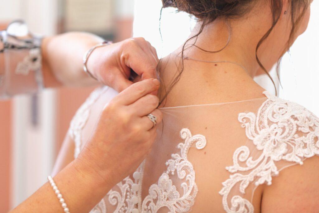 brides necklace fastened bridal prep rishworth sowerby bridge oxfordshire wedding photographers