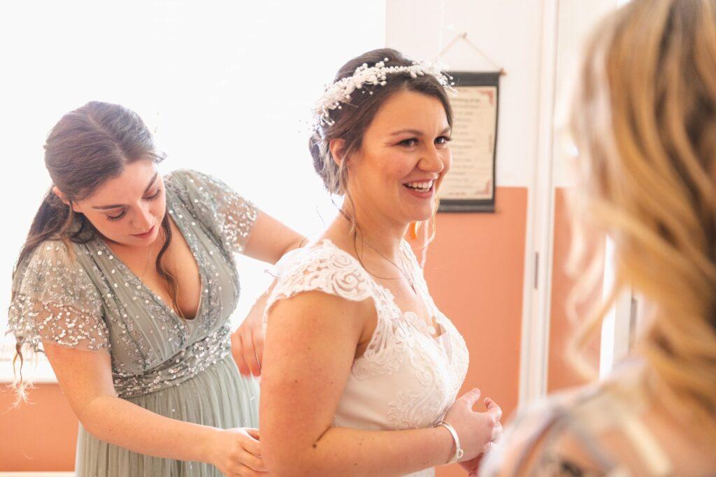 bride smiles at mother bridal preparation sowerby bridge marriage oxford wedding photographer