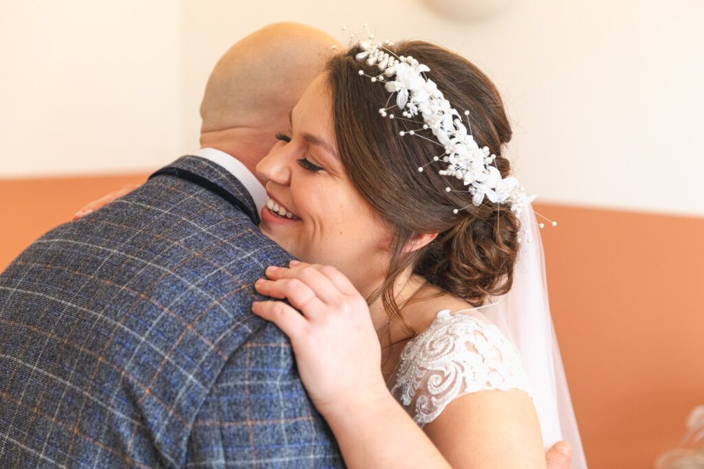 bride hugs father of bride first dress look sowerby bridge marriage oxfordshire wedding photographers