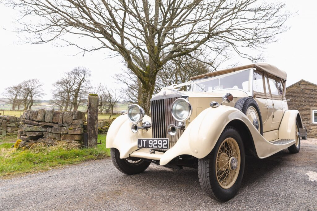 classic bridal car awaits bride st johns church ceremony rishworth oxford wedding photographer