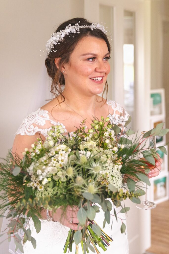 bride holds floral bouquet st johns rishworth marriage ceremony oxford wedding photography