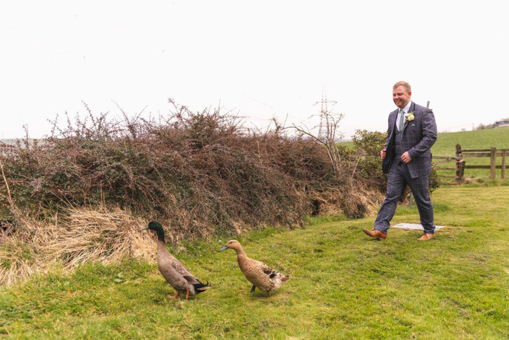 groom chases geese west yorkshire wedding rishworth sowerby bridge oxford wedding photographer