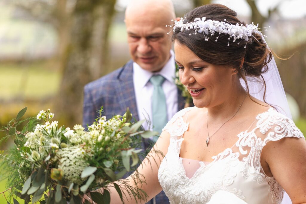 bride carries bouquet father of bride escorts st johns church rishworth ceremony oxford wedding photographers