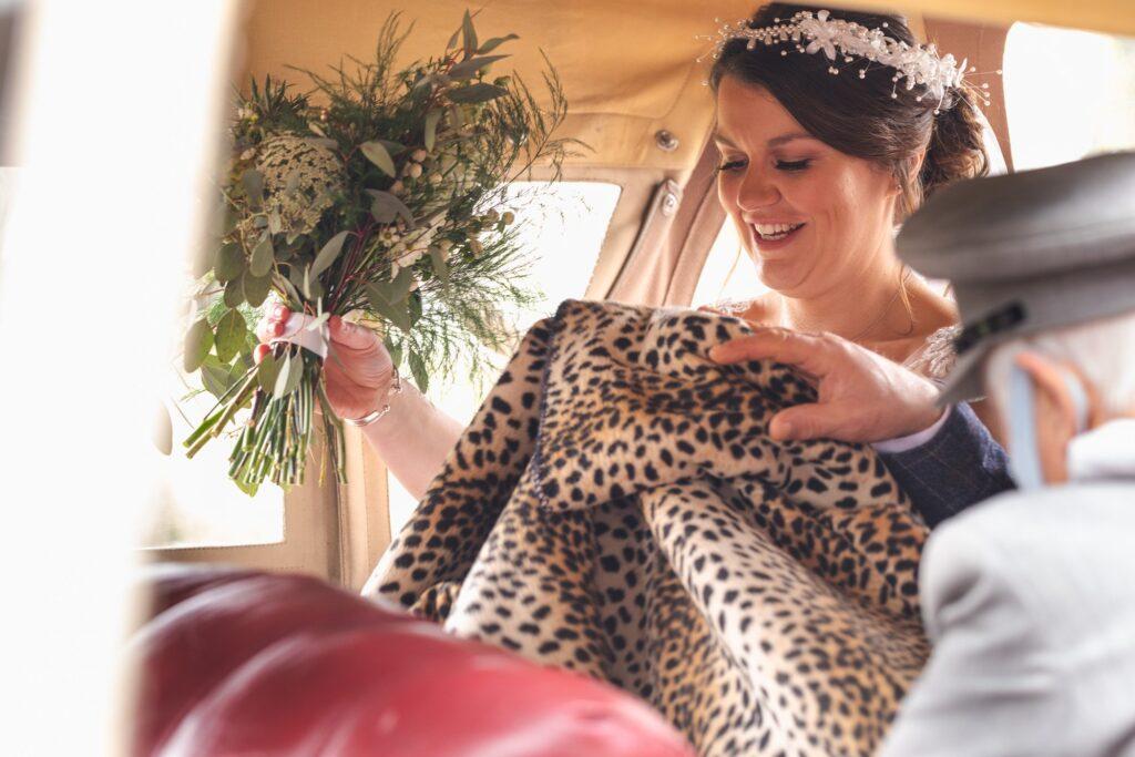 chauffer passes brides bridal car rug rishworth marriage ceremony oxford wedding photography