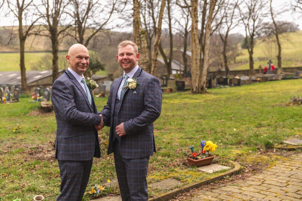 groom greets father of bride st johns churchyard rishworth sowerby bridge oxford wedding photographers