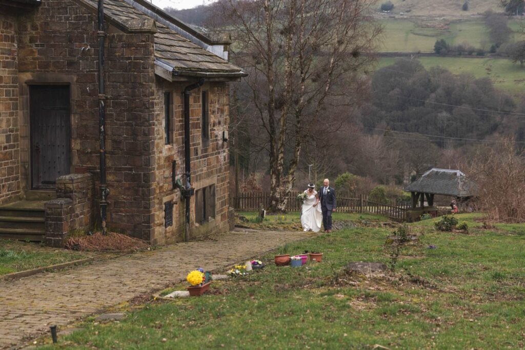 father of bride escorts daughter st johns churchyard rishworth sowerby bridge oxford wedding photographers