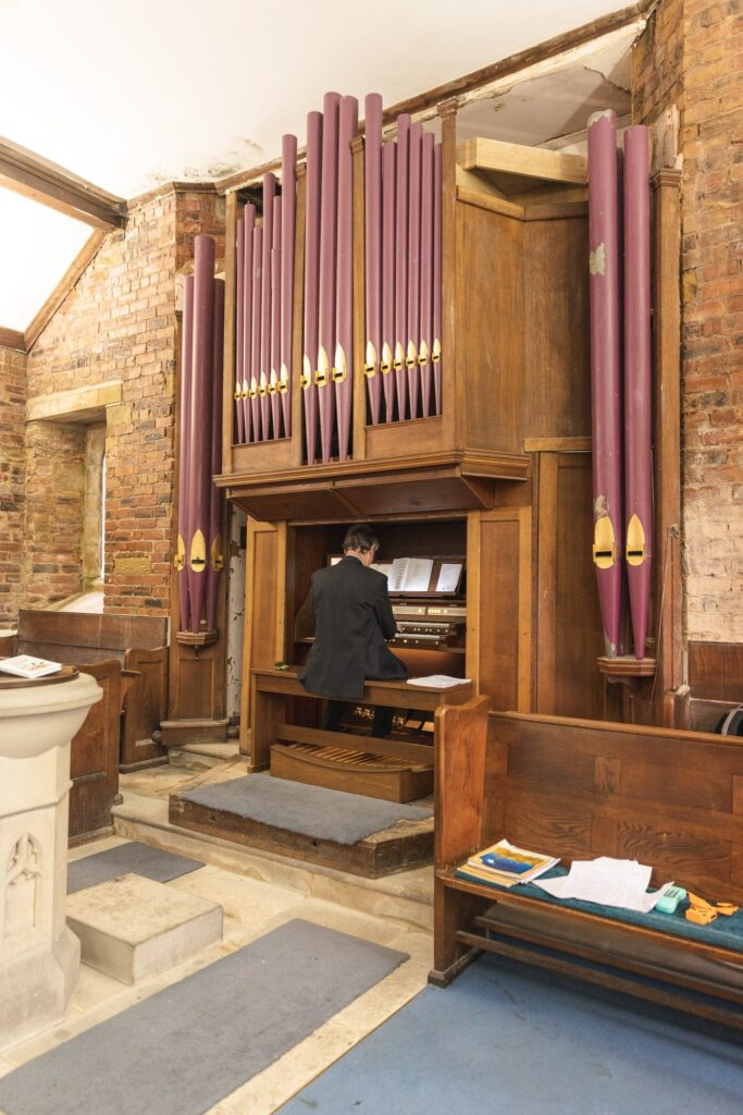 organist plays st johns church marriage ceremony rishworth oxfordshire wedding photographer