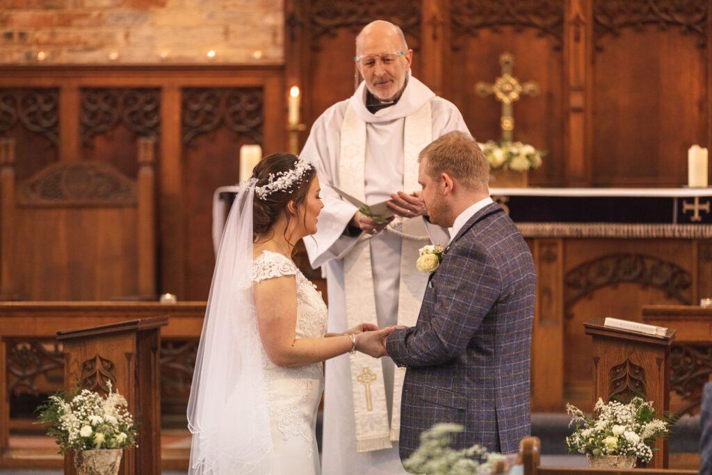bride groom exchange vows st johns church rishworth sowerby bridge oxfordshire wedding photography