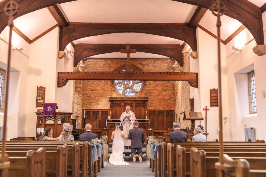 kneeling bride groom covid micro wedding st johns church rishworth sowerby bridge oxfordshire wedding photographers