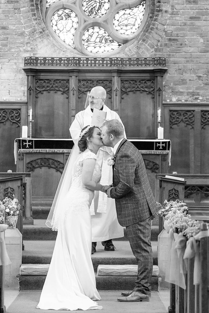 bride groom first kiss covid micro wedding ceremony st johns church rishworth oxford wedding photography