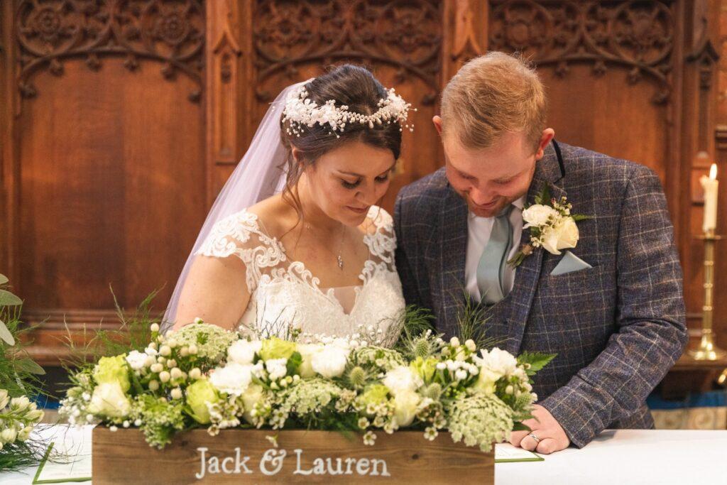 bride groom sign marriage register st johns church rishworth sowerby bridge oxfordshire wedding photography