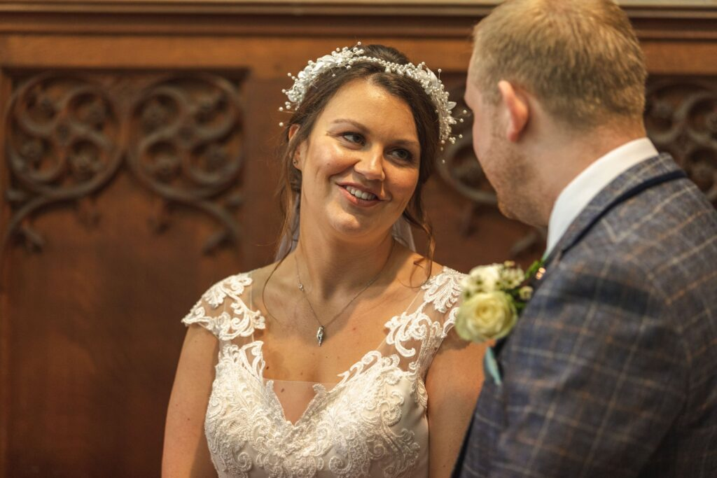 brides loving look st johns church marriage ceremony rishworth sowerby bridge oxford wedding photographers