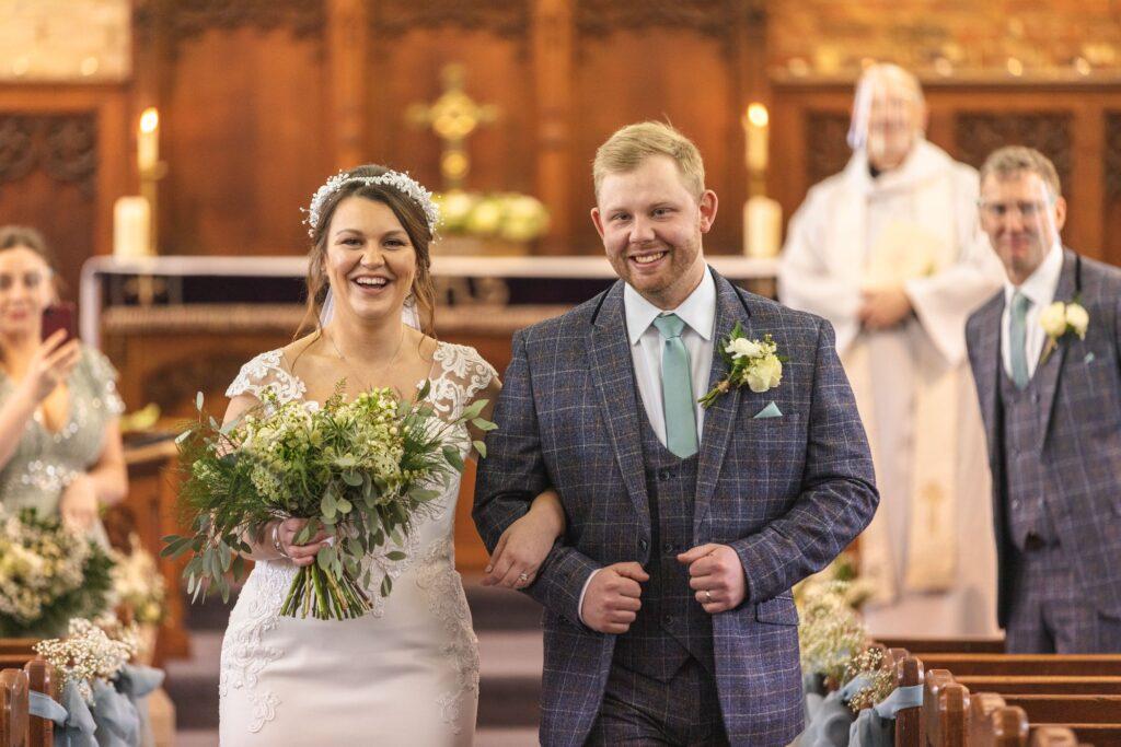 smiling bride groom just married covid micro wedding st johns church rishworth oxford wedding photographer