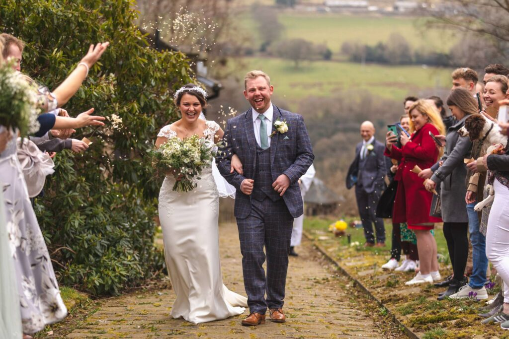 bride grooms confetti parade st johns churchyard rishworth sowerby bridge oxfordshire wedding photographer