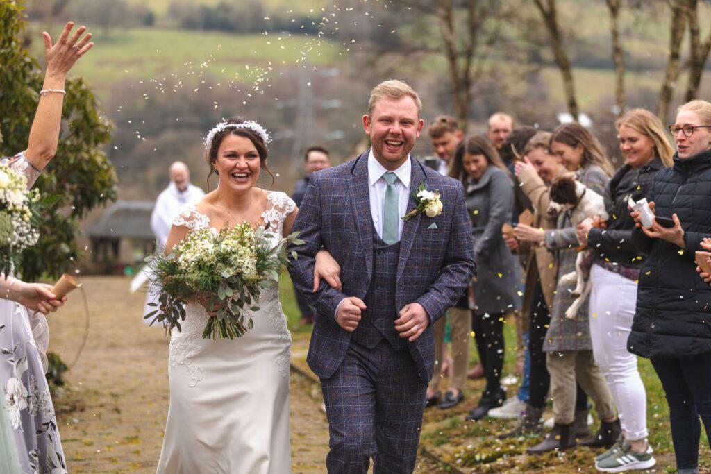 bride groom enjoy confetti shower st johns church rishworth oxfordshire wedding photographers