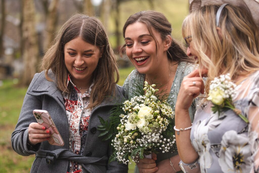 mother of bride bridesmaid view guests photograph st johns churchyard rishworth oxford wedding photographer