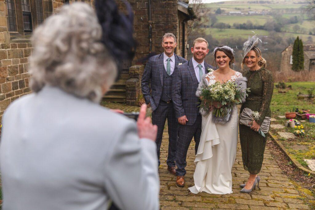 guest photographs bridal party st johns churchyard rishworth sowerby bridge oxford wedding photography