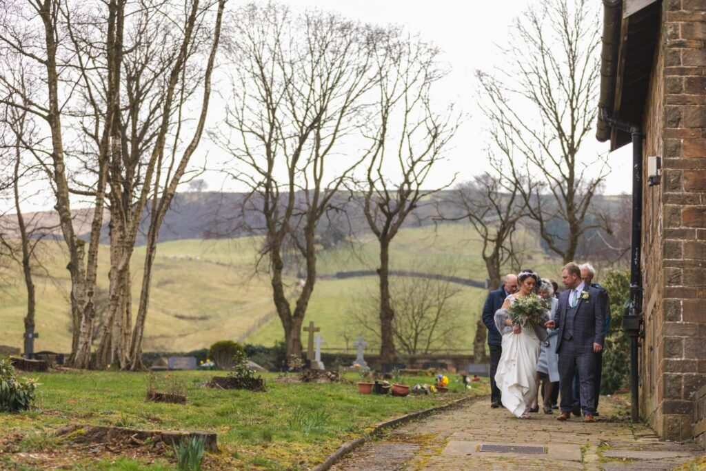 bridal party leave st johns churchyard west yorkshire wedding oxfordshire wedding photographers