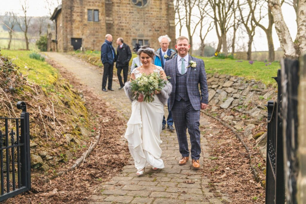bride groom leave st johns church west yorkshire wedding oxfordshire wedding photography