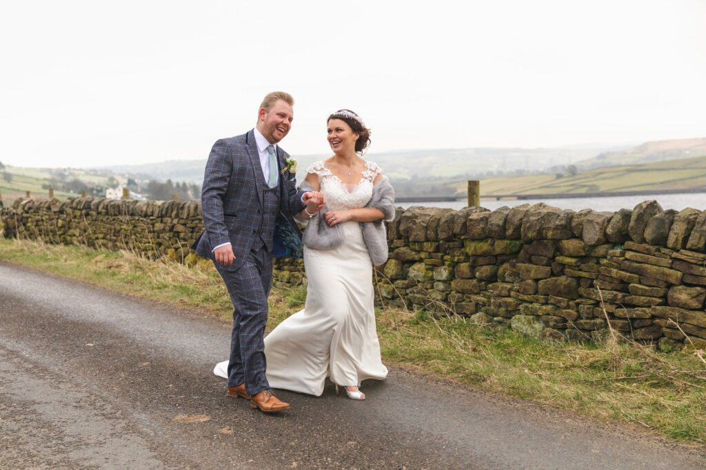bride groom enjoy countryside stroll west yorkshire wedding rishworth sowerby bridge oxford wedding photography