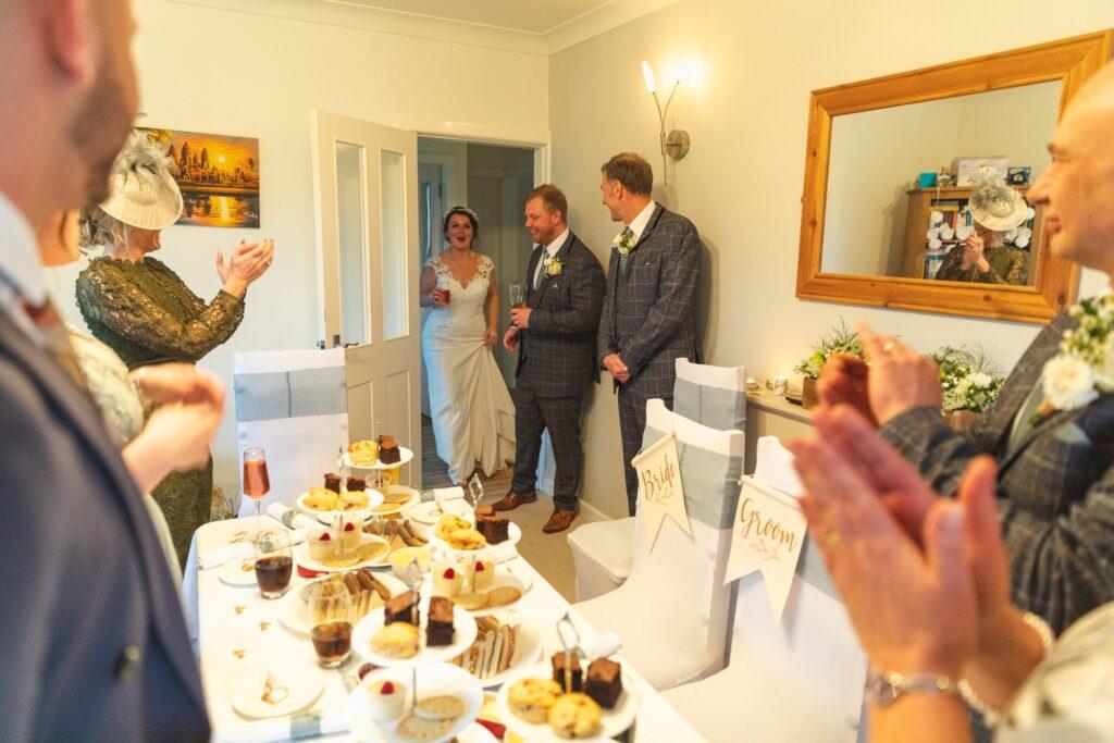 guests applaud bride groom west yorkshire wedding breakfast entrance oxfordshire wedding photography