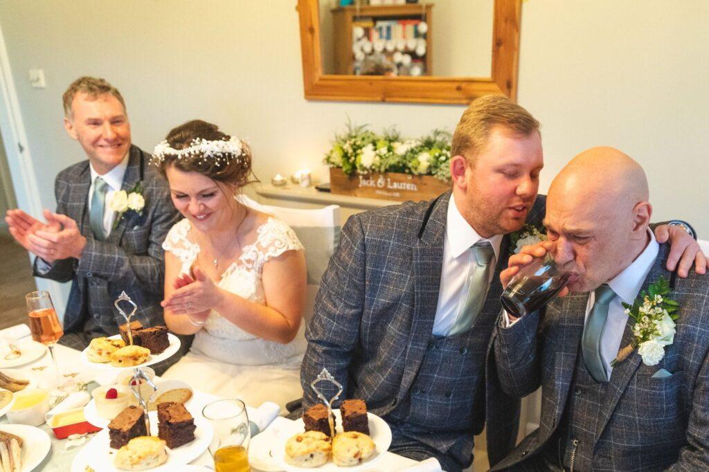 groom comforts father of bride west yorkshire wedding breakfast oxford wedding photographer