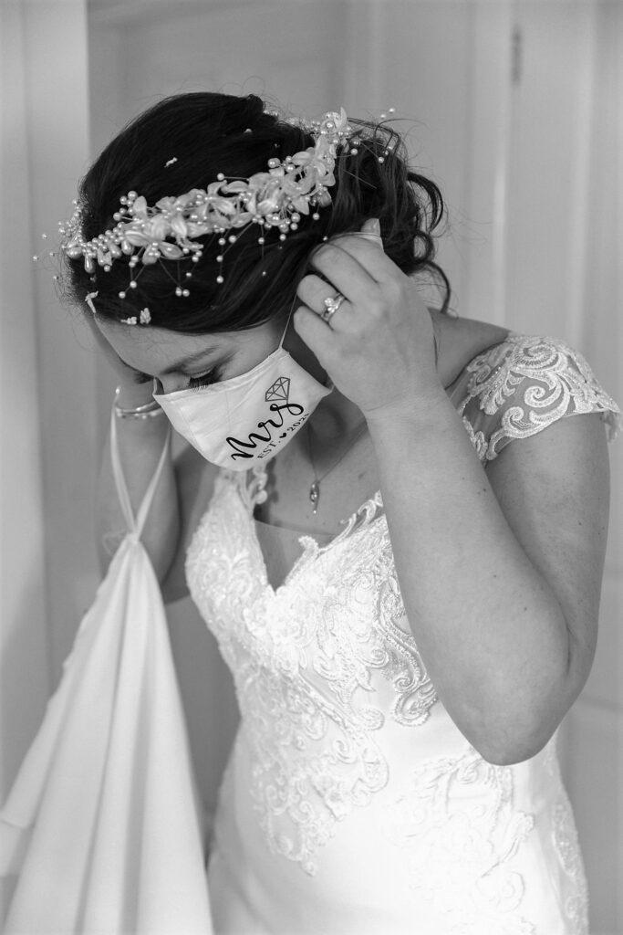 bride adjusts covid face mask west yorkshire wedding oxfordshire wedding photographer