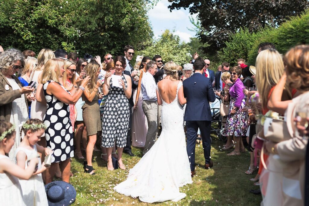 05 bride groom with invited guests at garden reception oxfordhire wedding photography