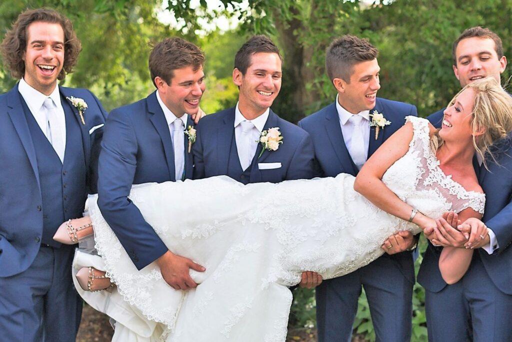07 groom groomsmen carry bride garden reception oxfordhire wedding photography