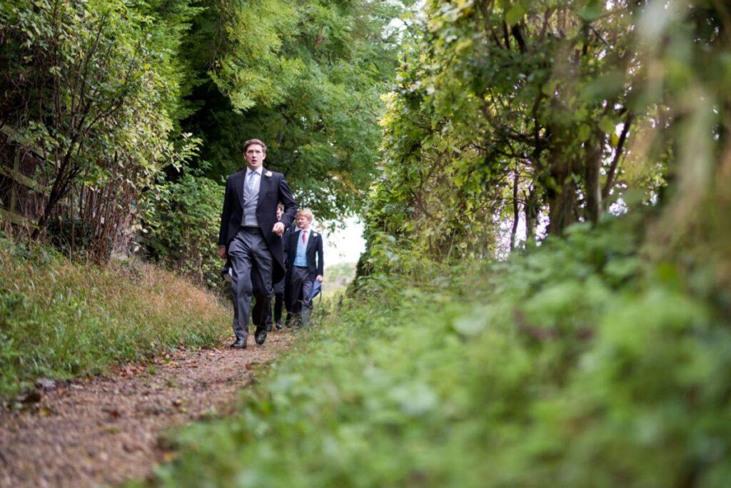 12 groom groomsmen walk to ceremony church of st michael aston tirrold oxfordshire oxford wedding photography
