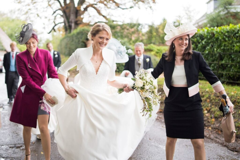 14 guests lift brides train church of st michael ceremony aston tirrold oxfordshire oxford wedding photographers