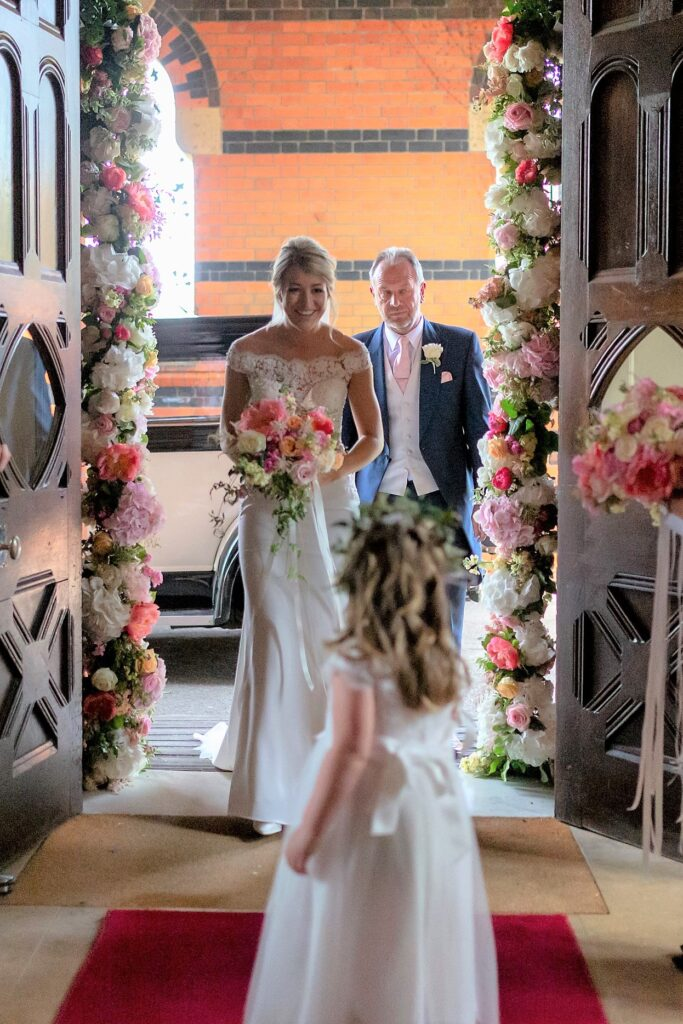 26 bride father of the bride enter marriage ceremony the elvetham hartley wintney hampshire oxford wedding photographer