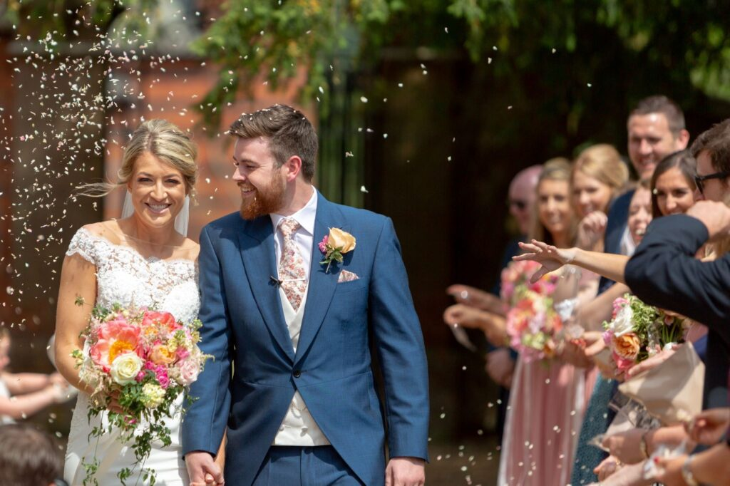 29 bride groom confetti shower the elvetham hartley wintney hampshire oxfordshire wedding photographers