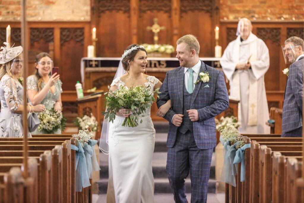 bride and groom aisle walk covid mircro wedding st johns church rishworth oxfordshire wedding photography