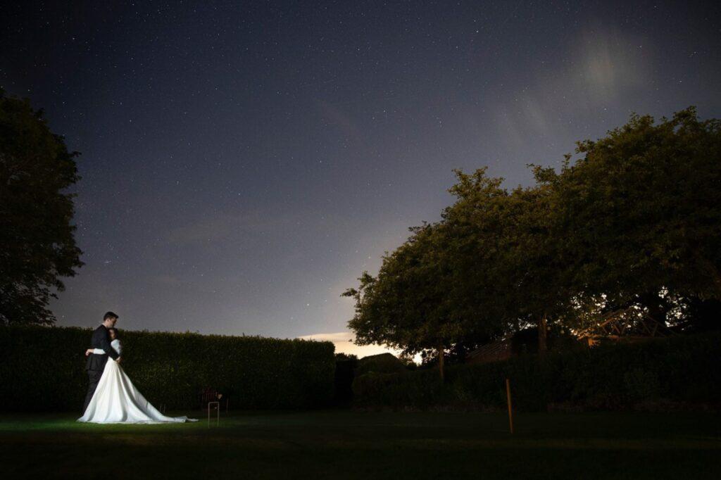 bride groom embrace beneath starry night ski wasing park aldermarston berkshire oxfordshire wedding photographer