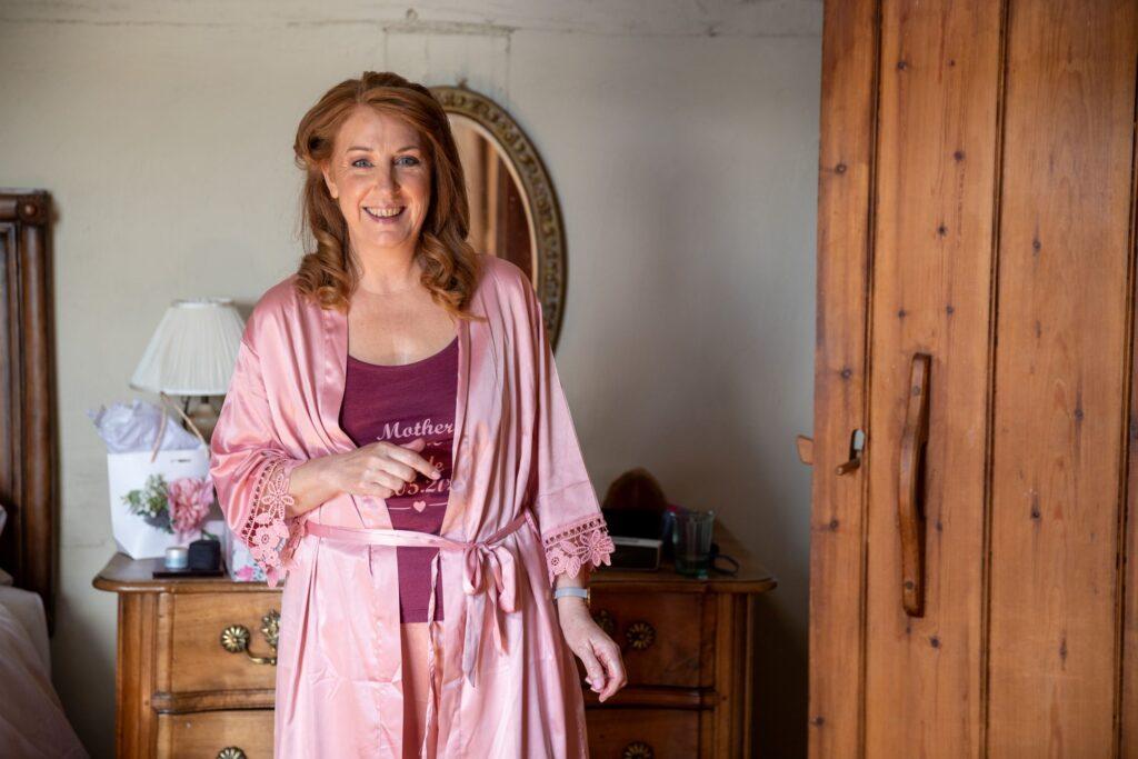 10 smiling mother of bride bridal prep pauntley court gloucester oxfordshire wedding photographer