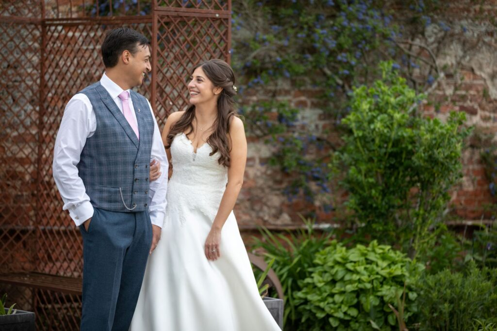 102 smiling bride holds grooms arm pauntley court gardens gloucester oxford wedding photography