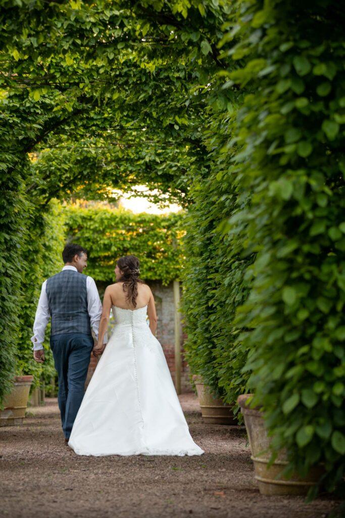 103 bride groom stroll holding hands pauntley court beech grove gloucester oxfordshire wedding photographer